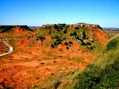 The Black Kettle National Grassland, located in Roger Mills County, Oklahoma and Hemphill County, Texas, is characterized by sandy & red slate hills, grassland & oak brush.