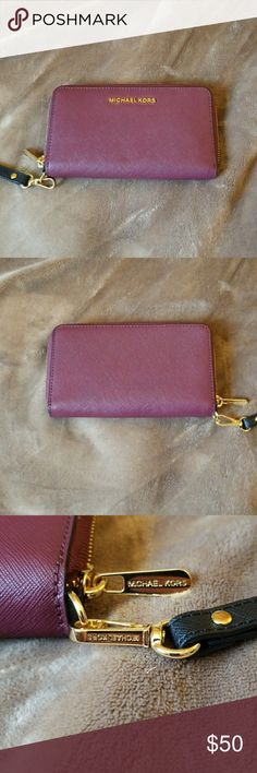 Michael Kors Maroon Wristlet I bought this at Nordstrom and never used it. I can hold a large cellphone. I don't have an iPhone but it will fit my Galaxy S8+. I can only assume that it will fit any large phone. New without tags Michael Kors Bags Wallets