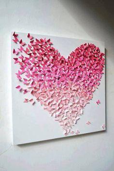 Vlinder hart schilderij, gemaakt van vlinders met een pons uit verschillende overlopende kleuren papier.