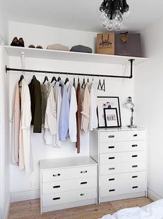 Minimalist open concept closet with white dressers
