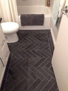 The floor tile pattern in this bathroom is the star of the show with clean white providing a dramatic contrast.