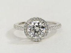 Diamond Halo Engagement Ring... Looks kinda like my ring... I love it