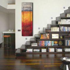 shelves in the stair case. space saver!