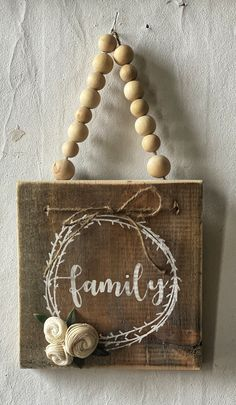 Petite and Powerful reminder family first. This sign roughly in size of is has a dark stain with white painted wreath and family with natural beaded hanger and wood flower accents. Scrap Wood Crafts, Wood Block Crafts, Wood Projects, Craft Projects, Bead Crafts, Jewelry Crafts, Diy And Crafts, Simple Crafts, Home And Garden Store