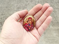 Miniature icon painted on a handmade wooden cabochon, blog.sowiarnia.pl