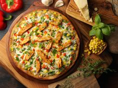Our Spicy Chicken Fajita gluten-free pizza is loaded with roasted corn and peppers, cilantro, onion, olive oil garlic sauce, chipotle spices and mozzarella cheese. Olive Oil Garlic Sauce, National Pizza Month, Roasted Corn, Gluten Free Pizza, Homemade Sauce, Chicken Fajitas, Menu Restaurant, Pizza Recipes, Vegetable Pizza