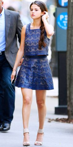 Selena Gomez wears a navy, perforated Parker Kelsey Top and a Parker Filomena Skirt in NYC