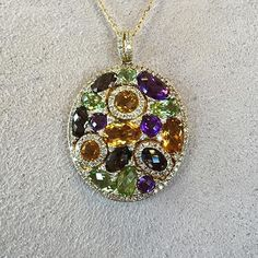 """Love was a feeling completely bound up with color, like thousands of rainbows superimposed one on top of the other."" Paulo Coelho We love this multi-gemstone pendant! Stop by our Summit location to check this beauty out! #love #gemstones #pendant #brombergsjewelry #brombergssummit"