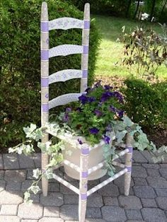 painted chair, hole in seat for flower pot. I have this!!! Except my chair doesn't have a seat… I put a board on the rungs to hold the flower pot.