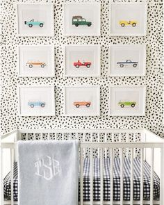Gallery wall of photos by Leslee Mitchell over a nursery (via Instagram).