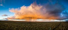 Cloud full of everything - sun, showers, rainbow, by Marcos Furer