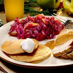German-Style Red Cabbage Recipe Side Dishes with butter, granny smith apples, onions, red cabbage, white vinegar, firmly packed brown sugar, all-purpose flour, salt, pepper, dry red wine