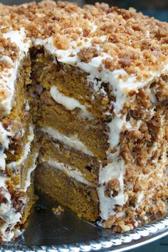 Great pumpkin crunch cake with cream cheese frosting.  The perfect dessert recipe for your holiday / Thanksgiving table.