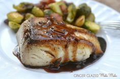 Ginger Glazed Mahi Mahi: This quick and easy weeknight dinner is super easy and full of flavor. Only 7 ingredients!! Plus, it's good for you! Click through for the recipe.