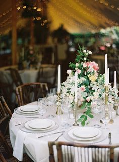 An elegant affair....love the florals and tall candles