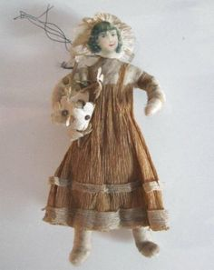 Young girl with basket spun cotton ornament