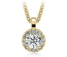This halo diamond pendant setting in yellow gold may be set with your choice of center diamond (not included). Suspended by a yellow gold cable-link chain.