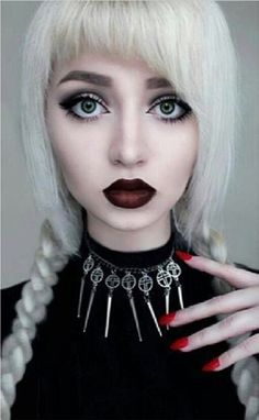 white hair, black cherry lipstick, and sage green eyes  posted by dropdeadkidz on instagram