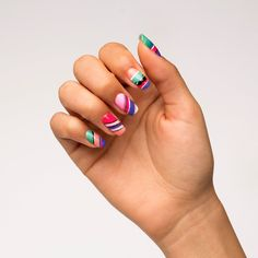 Rock a fiesta on your fingertips with Cinco de Mayo-inspired nail art! All you need is bright colors and a striping brush to get started —check out this easy tutorial!
