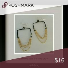 "Annealed Steel and Gold Chain Earrings Hammered bent annealed steel with cascading gold chains. Width: 1 1/4"". Length: 2"". Jewelry Earrings"