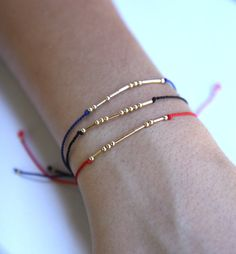 This is a timeless gold filled morse code bracelet. Tiny beads are carefully strung on a thin, high quality silk cord.