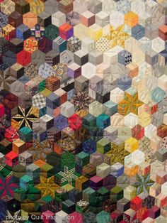 close up, Universal Ties by Nancy Ota, made with men's neckties.  Hand pieced and quilted.  Photo by Quilt Inspiration