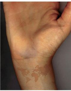 40 world map tattoos that will ignite your inner travel bug map world map tattoo done in brown ink to look like a birth mark gumiabroncs Image collections