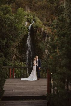 We can't get enough of this wedding portrait in front of a waterfall | Image by Tressa Wixom Photography