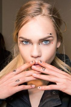 Giamba forecasts this year's music festival makeup with quirky face tattoos and ultrathin braids: //Manbo