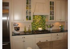 Mosaic tiles are beautiful all over or as an accent, such as in this bright green stove insert!