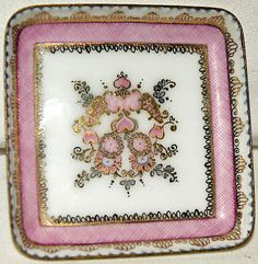 Beautiful little trinket dish    Hand made in Austria    Decorated in pinks and white with gilt - flowers and hearts    Handmade in austria and 24 2 and an A in a circle underneath    In perfect condition  £9.99