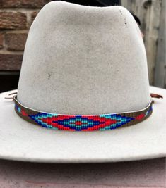 Items similar to Beaded One Feather Design Hatband in Blues and Reds on a Earth Tone Background. Great for Cowboy and Straw Hats. on Etsy Beaded Hat Bands, Native Beading Patterns, Native American Beadwork, Feather Design, Bracelet Crafts, Felt Hat, Shades Of Red, Loom Beading, Bracelet Designs