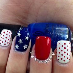 Cute stars and polka dots adorn this patriotic nail art perfect for Memorial Day Weekend.