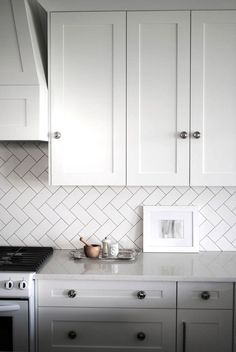 Creative-Kitchen-Backsplash-herringbone-white Like the different pattern of laying out the tiles
