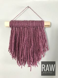 A personal favorite from my Etsy shop https://www.etsy.com/ca/listing/604035777/mauve-mini-yarn-wall-hanging