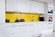 white kitchen yellow tile backsplash