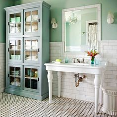 Vintage Bathroom: A vintage console sink, classic bungalow style tile work, and the cabinet that adds storage and style.