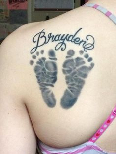Add Seth and Austin's foot print to the tattoo I already have with their names.