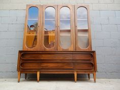 Great little mid century modern hutch/buffet cabinet with plenty of storage for your china, collectibles, or anything else you want to display in a beautiful setting. It would also make a great lit…