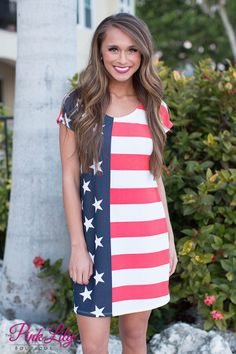 Feel alive and free in our new American Flag Dress! It's the perfect look for Fourth of July or even just an easy, everyday look! Featuring a bold stars and stripes pattern, this comfortable dress is lightweight and stretchy. It also has a scoopneck and short sleeves - simple and classic!