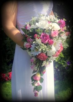 Brides large teardrop long bouquet with real touch roses,foam roses and gerbera in hot pink and greenery