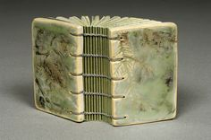 """""""Dwarf Spruce"""" by Susan Joy Share coptic binding with waxed linen thread and porcelain clay covers by Paul Stang. Handmade Journals, Handmade Books, Old Books, Antique Books, Book Art, Book Sculpture, Porcelain Clay, Book Binding, Illuminated Manuscript"""