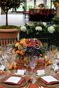 Love the fruit and flower centerpieces