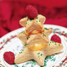 "Puff pastry cut into evergreen tree shapes are baked and filled with creamy pudding. Let the kids help decorate the ""trees"" with colored sugar and cherry halves before they dig in! Get the recipe here: http://bit.ly/u9mf6m"