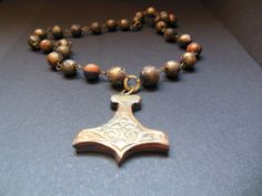 Items similar to Polymer clay orange, blue, bronze colour Thor's Hammer, Mjolnir necklace. on Etsy Thor's Hammer Necklace, Asatru, Polymer Clay, Beaded Bracelets, Bronze, Colour, Unique Jewelry, Handmade Gifts, Blue