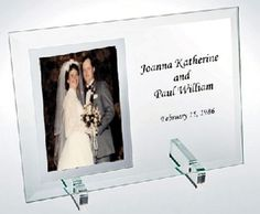 """Your names and wedding date engraved into a beautiful glass frame!  This is a great gift for engagements or for the wedding itself! It is a forever keepsake. Prices include the engraving of words on the clear glass area.  Graphics such as doves, hearts...are available.  4"""" x 6"""" $ 38.00    5"""" x 7"""" $ 42.00"""