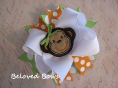 Embroidered Monkey Felt Spikey Boutique Style Hair Bow Orange Green White. $7.99 USD, via Etsy.