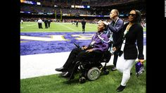 O.J. Brigance, left, senior player development adviser for the Baltimore Ravens, makes his way across the field with his wife, Chanda, prior to the start of Super Bowl XLVII. Brigance, a former Ravens player, was diagnosed with Lou Gehrig's disease in