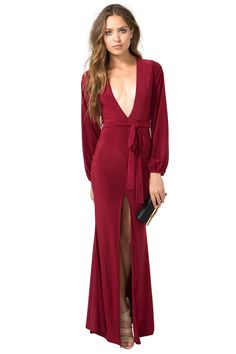 An insanely sexy maxi dress that'll have you shout, 'I look so good tonight!' Plunging v-neck. Long sleeves. Belt loops at the waist with a self-tie. Thigh-high front slit. Finished floor-length hem. Jersey knit. $35.50