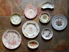 Here is a pretty set of 9 vintage English china transferware pieces. All are vintage. There is a variety of floral motif's, mainly in shades of sage green and pink / red with touches of brown, blue, y